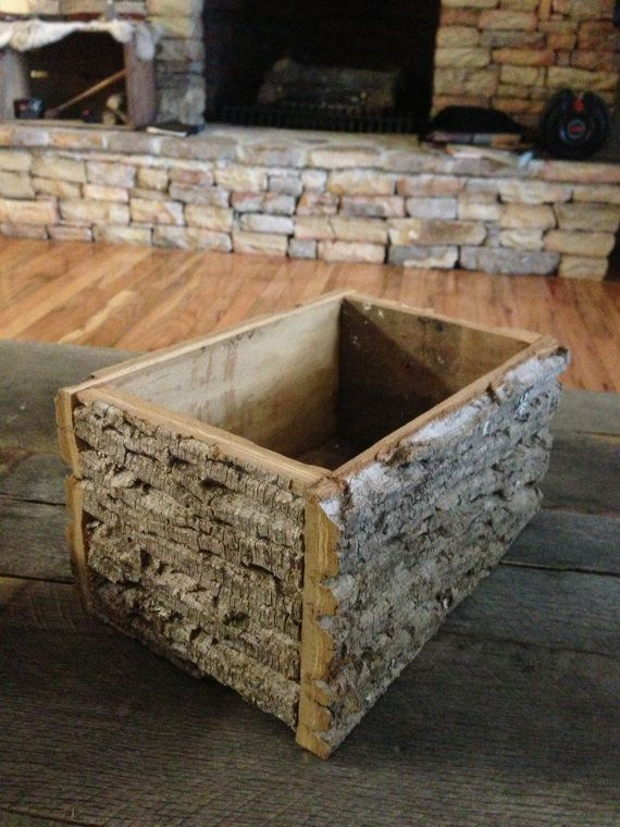Tree bark box on Etsy, $14.00   This would be great to have a bigger one for kindling!