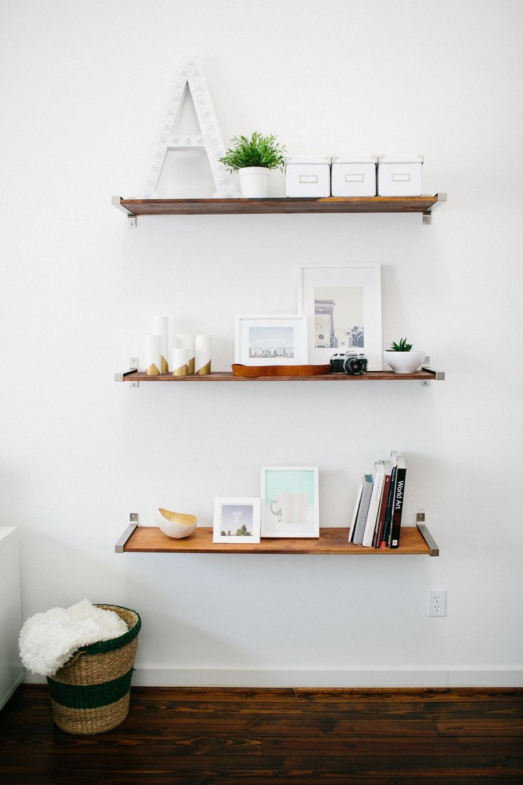 Ashley Rose's Houston Townhouse Tour // DIY wooden shelves // ikea hack // shelf styling // marquee light // living room storage // Photography by Kimberly Chau