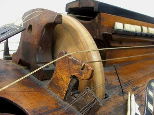 Hurdy gurdy from the 1700s (detail).  Probably the neatest instrument ever  :)  I would love to play one of these.