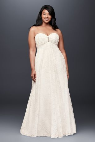 This soft and flowy empire-waist plus-size wedding dress, crafted of lovely, leafy lace, features a pleated sweetheart bodice accented by a crystal brooch.   David's Bridal Collection  Polyester  Sweep train  Back zipper; fully lined  Dry clean  Imported