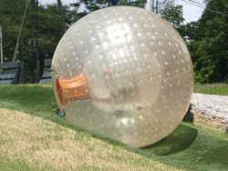 Roll down the hill in an 11' inflatable ball with 5 gallons of water in an inner chamber - crazy fun!