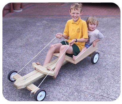 picture of kids in a billy cart.  I know several kids who would love this.