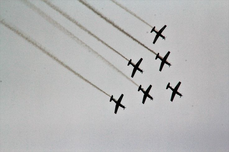 The RAAF Roulettes entertain the crowd during the Australian Motorcycle Grand Prix