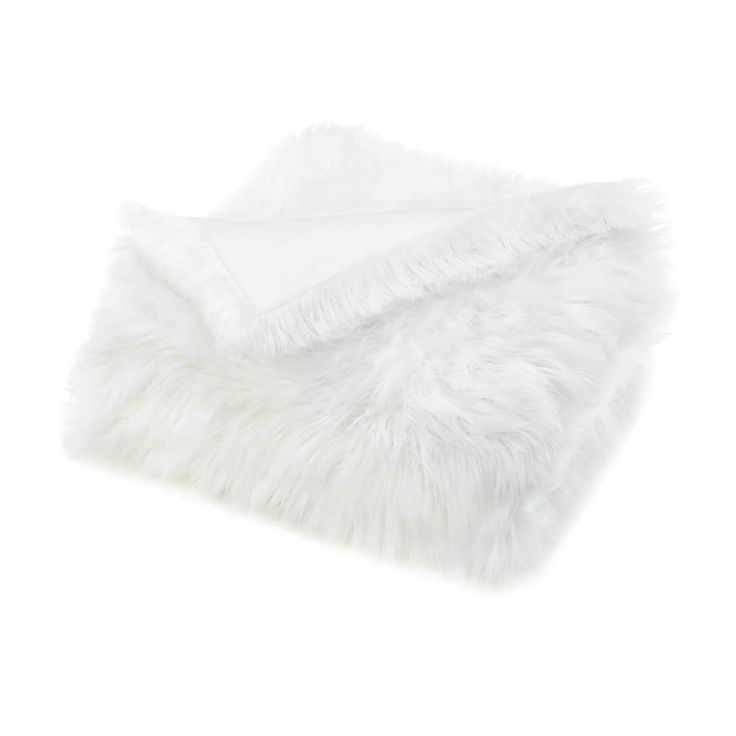 Lounge in luxury with this pretty white blanket! One side of this stylish throw blanket features long faux fur that is sumptuously soft to the touch. It'll look modern and glamorous on the back of you