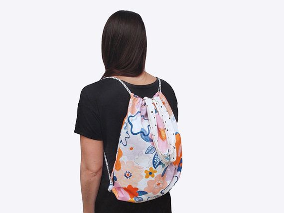 Garden Mirage Daybag - a versatile backpack and tote back with bright floral pattern