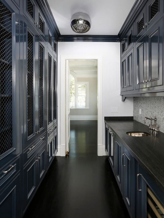 Markay Johnson Construction: Galley style butlers pantry with black floors and countertops and glossy navy blue ...