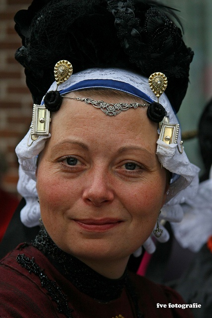 Europe | Portrait of a woman wearing a traditional hat, Schagen, Noord-Holland, The Netherlands | Frits van Eck