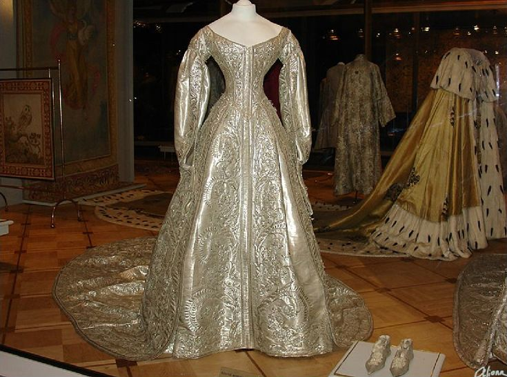 1856 Maria Alexandrovna's coronation gown (foreground) and Alexandra Feodorovna's coronation mantle (background)(wife of Tsar Alexander II of Russia)