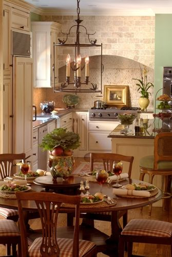 French country kitchen with wood floors and cream cabinets