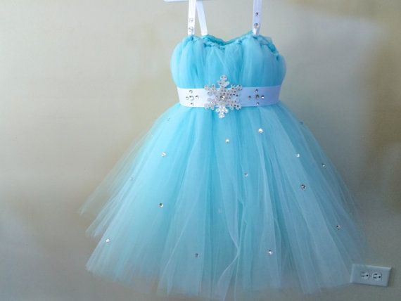 This tutu dress is made with endless amounts of Tiffany Blue colored tulle material to ensure fullness. Tons of clear gems are placed along the