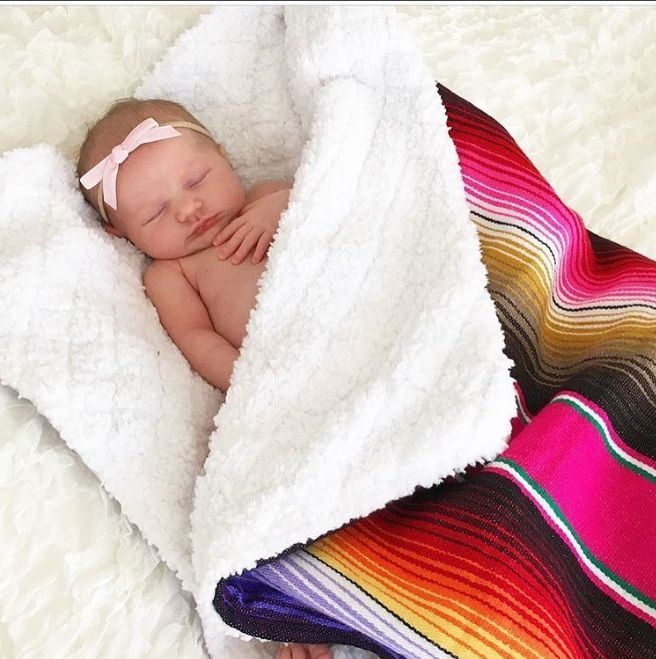 Baja Baby Mexican baby blanket. Super soft sherpa on one side and Mexican serape blanket on the other.