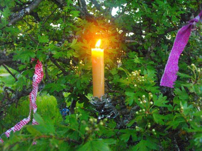 """Since ancient time across the British Isles, candles were lit at dusk on May Day and ribbons tied to its branches to ask for luck and blessings. Even today you'll find """"wishing trees"""" covered in colorful strips of fabric (red or pink for love, blue for protection, green for wealth and violet for spiritual insight) asking for the fulfillment of prayers or wishes."""