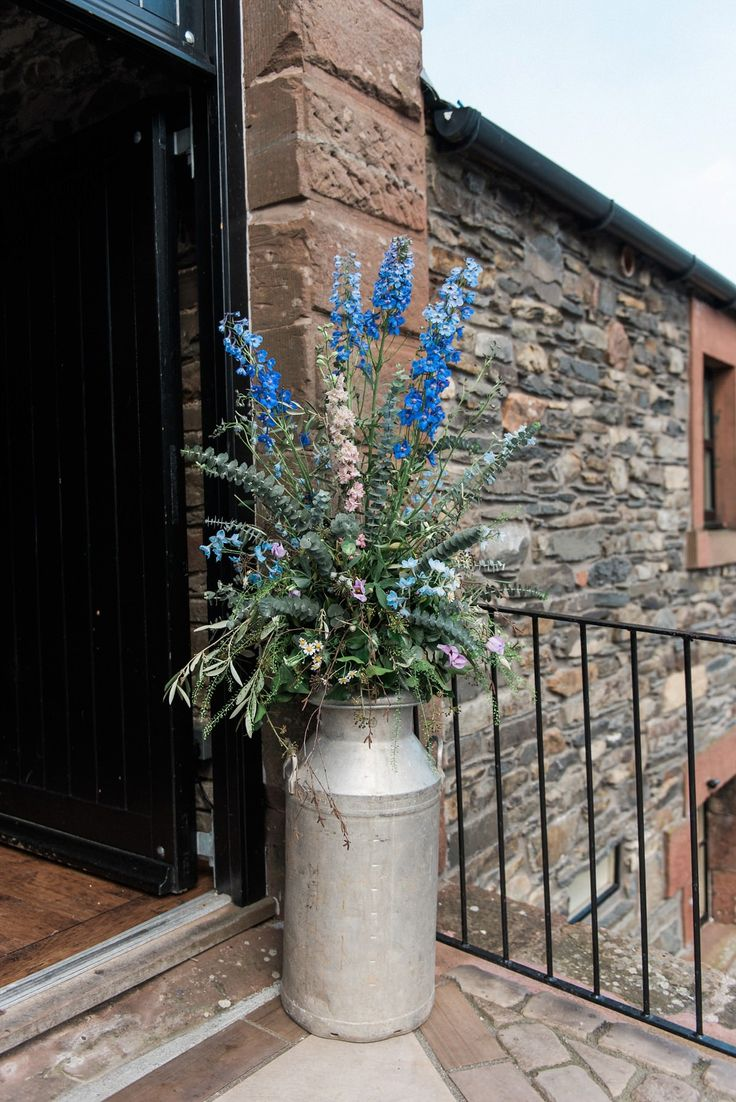 Rustic milk churn & wildflower display. Photography by http://www.folegaphotography.co.uk/