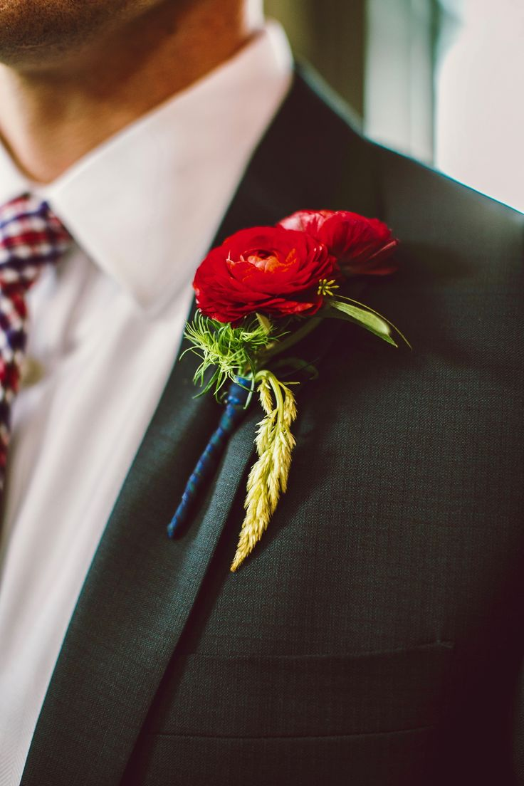 A trendy red ranunculus boutonniere for Kyle's groomsmen. Diamond Street Photography.
