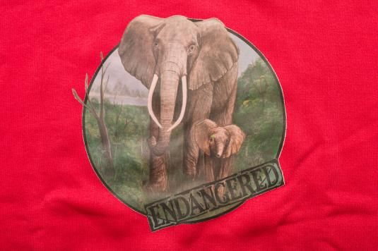 For sale here is a vintage late 80s to early 90s endangered elephants crewneck sweatshirt in a salmon pink color; made in USA. It is in very good vintage condition with no tears or holes. There is one pea-sized stain on the arm (see last pic). The graphics are excellent. It could use a washing to freshen it up. Would be a great sweatshirt for the animal lover!Pit to sleeve end is 22.25