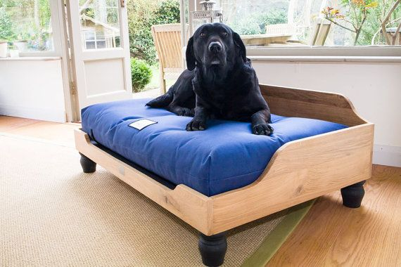 A raised wooden dog bed hand-made using English Oak. Finished by hand and waxed to bring out the rich, natural color and grain. The base is slatted and raised to allow for ventilation and easy cleaning. You'll have to purchase the dog bed mattress separately. That's how we humans like to buy beds, too.