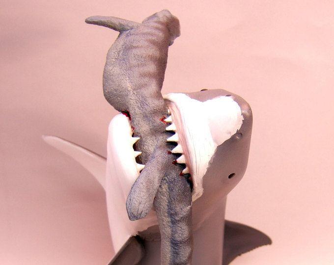 Megalodon attacking mosasaur  sculpted by Brian Blacknick