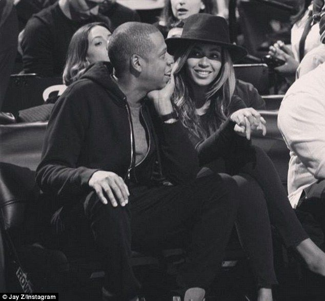 Secret collaboration? Beyoncé continued to fuel pregnancy rumours while at Monday night's Brooklyn Nets game with husband Jay Z