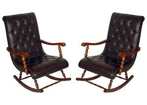 MID CENTURY MODERN ROCKING ARMCHAIRS IN WALNUT AND LEATHER IN THE MANNER GIO' PONTI