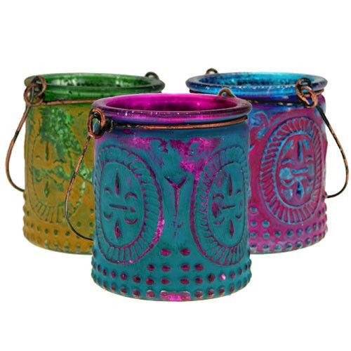 BohemianGlass Votive Candle Holders... that can also be used as vases. The perfect addition to gypsy weddings and the colors are simply amazing. Set of 3 shown