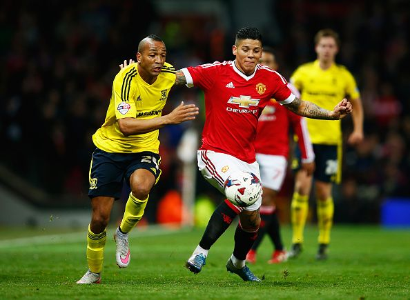 Emilio Nsue of Middlesbrough takes on Marcos Rojo of Manchester United during the Capital One Cup Fourth Round match between Manchester United and...
