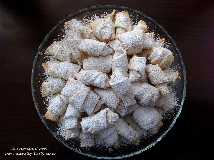 Cornulete fragede cu untura si rahat.  Little rolls stuffed with Turkish delight. The dough is made with lard so the rolls are very soft, they actually are melting in your mouth!
