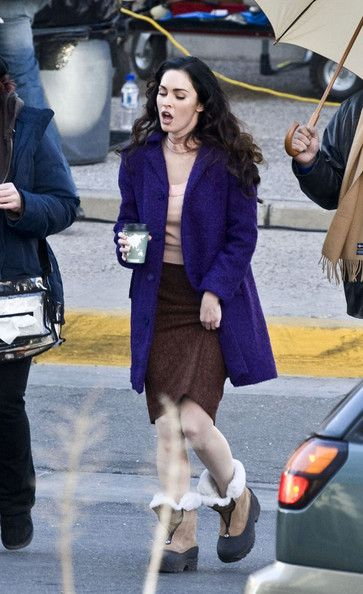 Megan Fox Lookbook: Megan Fox wearing Wool Coat (1 of 15). While shooting a scene for 'Passion Play,' Megan Fox is costumed in a fuzzy wool coat in an ultra bright shade of purple.and warm boots when not shooting. Wearing heels in the winter turns your feet into ice cubes!.