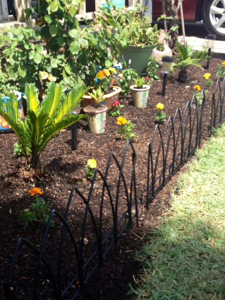 Wrought iron fence pieces to border a flower bed 3/ea on