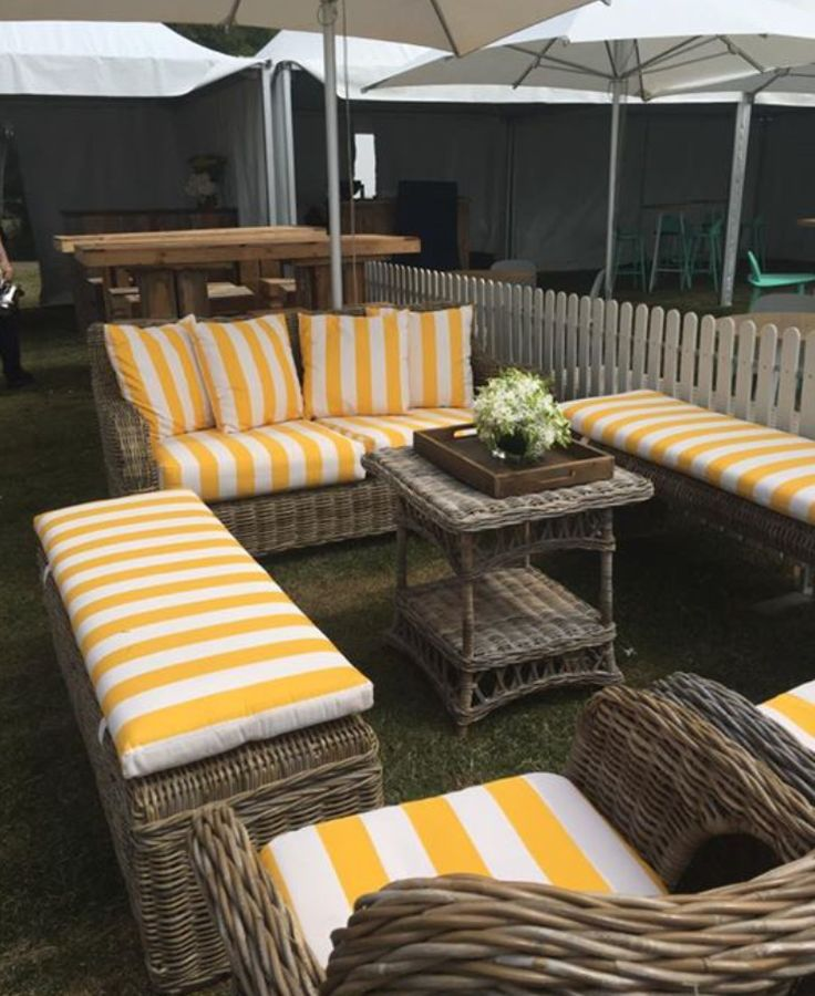 The ideal conversation pit at the Flinders Polo...happy yellow striped cushions perfectly paired with our Rattan Bench Seat