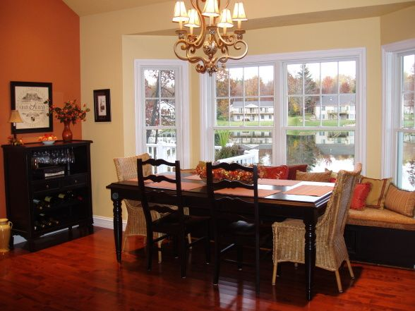 Dining room with window seat with a charming window seat for Dining room ideas orange