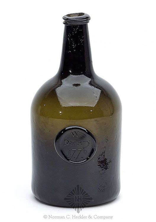"""""""W. / Daubeny / 1776"""" Applied Seal Wine Bottle, England, circa 1776. Cylindrical with large seal just below shoulder, deep yellow olive, sheared mouth with string rim - pontil scar, ht. 9 inches, base dia. 4 3/4 inches. Form and type similar to MW plate 45 #4 """"Attic"""" mint. An early English wine in a great traditional form. Big seal, big bottle, fine condition. Ex Rowland collection. #Bottles #Seals #MADonC"""