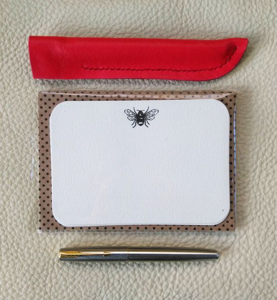 £14.50 A sleek luxury red pen cover or case, made of soft and supple leather in a pillar box red. Perfect for protecting your favorite pen when out and about. The minimalist design has an understated chic retro style. https://www.etsy.com/uk/listing/482074118/luxury-leather-pen-cover-in-pillarbox?ref=listing-shop-header-2   Luxury Leather Pen Cover in Pillarbox Red. Hand stitched, Stationary, Pen Case, Christmas, Gift for Her, Handcrafted, Retro, Rockerbilly