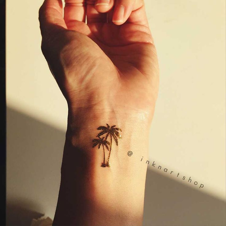 Makes everyday like vacation with this tiny gold palm tree tat!     This set includes  4pcs metallic gold Tiny Palm Tree temporary tattoo   Size: 2.5 x 1.5 cm each    Why not buy in bulk to save some shipping cost, check out more at:  http://inknart.storenvy.com/    Follow us at Facebook for more...