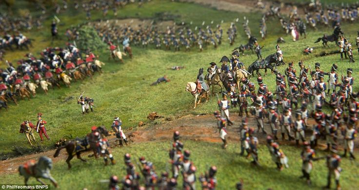 General: Napoleon, pictured riding a white horse, is shown directing his troops in the uns...