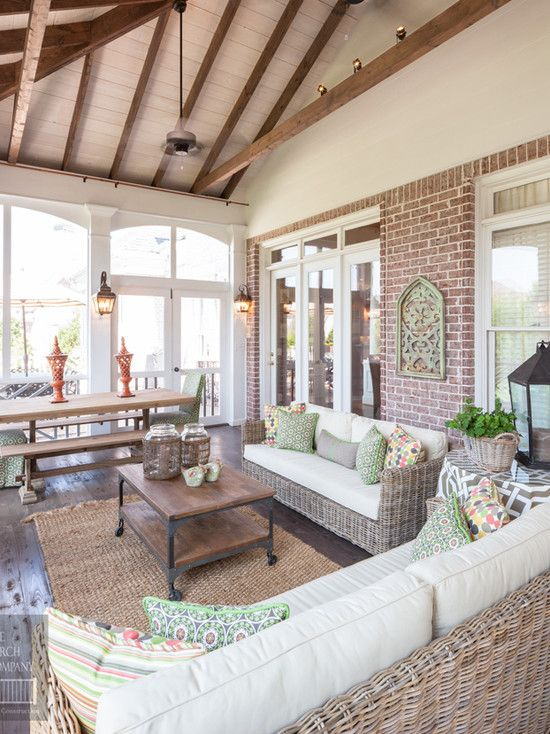 Dream house wish list: beautiful enclosed porch. I love the brick, I love the wooden beams, I love it all. Gorgeous