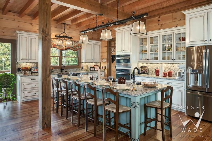 What an adorable log home kitchen.