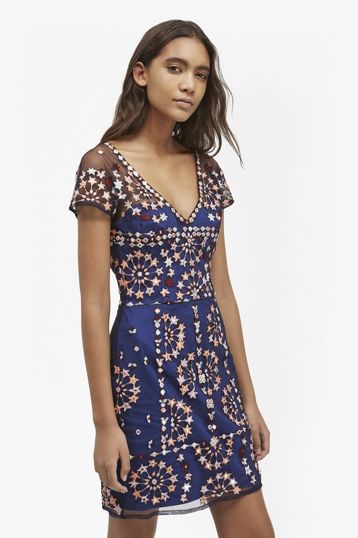 "<ul> <li> Cotton-sateen fitted occasion dress with mirrored sequin embellishment and Moroccan tile-inspired embroidery</li> <li> V-neck</li> <li> Structured, stretch boned bodice underlay </li> <li> Mesh overlay</li> <li> Stepped back hem</li> <li> Above-knee length</li> <li> Fitted bodice and figure-fitting skirt</li> <li> UK size 10 length is 85cm</li> </ul>  <strong>Our model is 5ft 10"" and is wearing a UK size 8.</strong>"