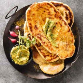 Homemade naan breads with a curry coriander garlic butter   | Woolworths.co.za