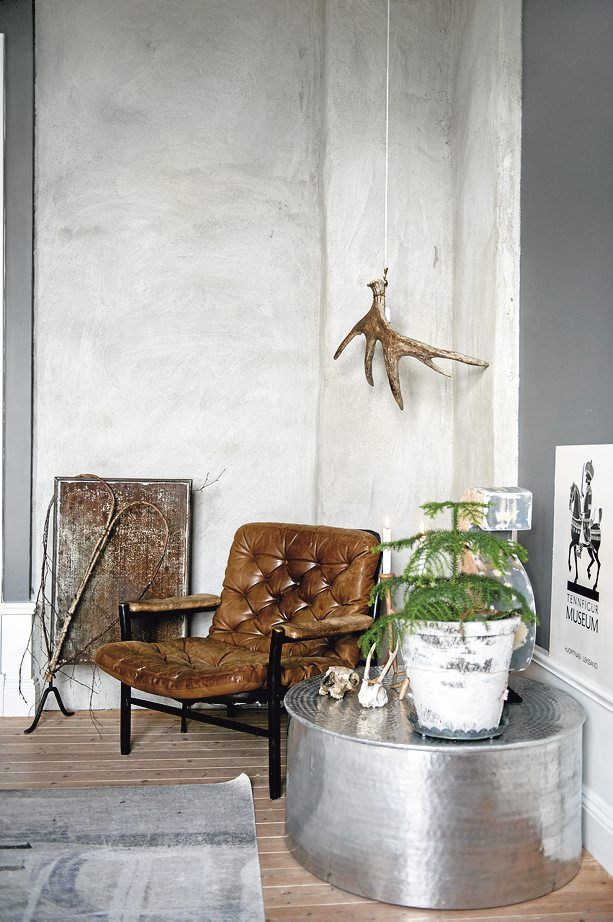 I actually like that antler hanging from the ceiling and the potted evergreen tree...