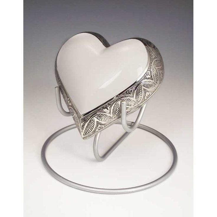 Pet Urns in heart shape designs.  Memorial stones, cremation urns for pets and people at Urn Garden.