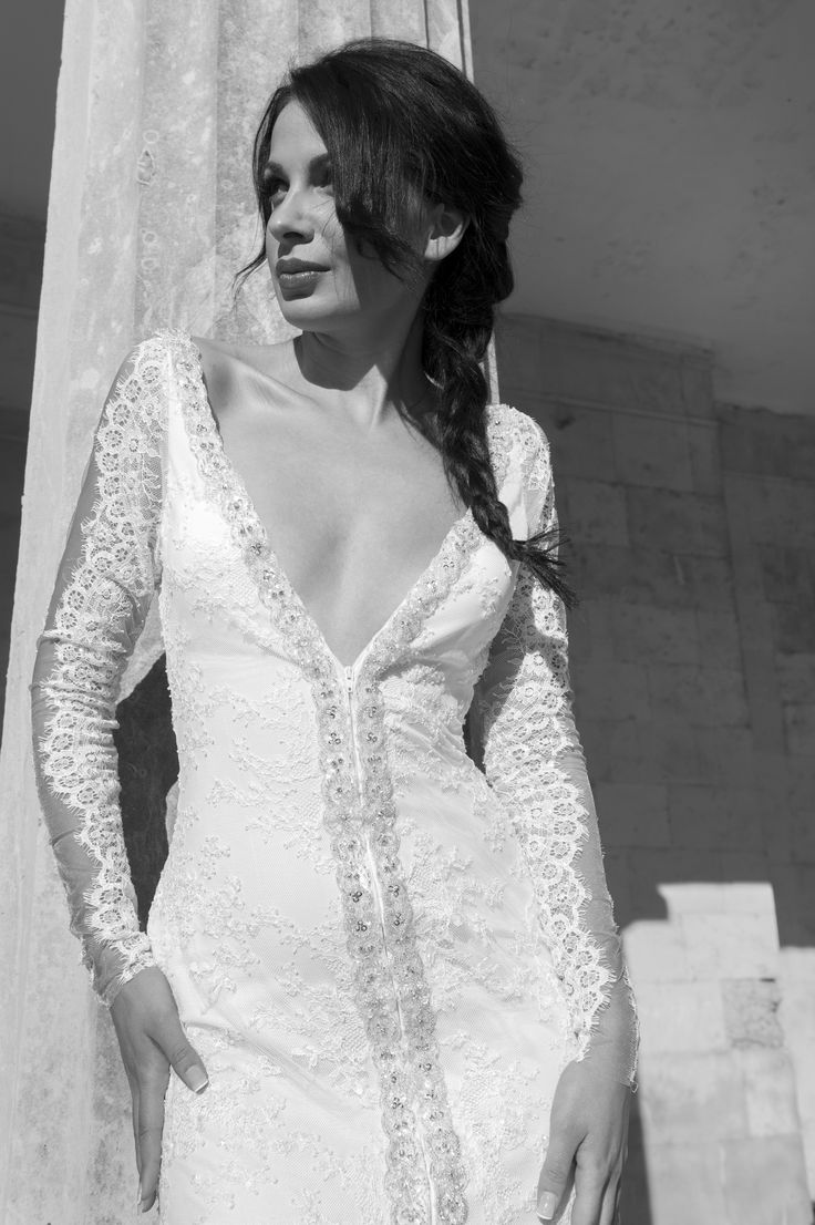 Sexy V neck wedding dress, beautiful emdroded lace with crystal detail by Marianna Kastrinos.