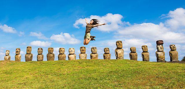 Jumping over Moai in Ahu Tongariki, Eastern Island