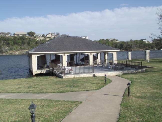 29 best boat house and docks images on pinterest boat for Boat garage on water
