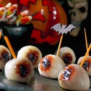 Creepy, squishy eyeball treats ...  Eyeballs on a Stick -   Ingredients:  1 can Grade AA lychees in syrup, drained and patted dried  4 teaspoons cherry, strawberry or raspberry preserves  20 large blueberries, canned