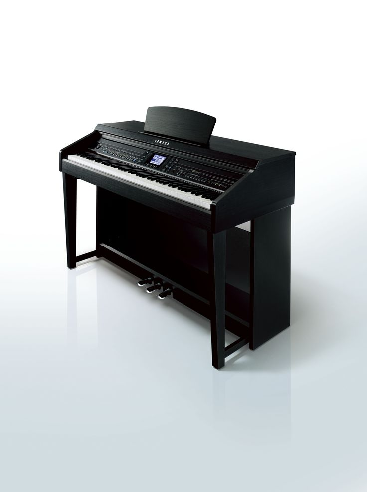 The Yamaha Clavinova CVP-601 digital piano in a black walnut finish.