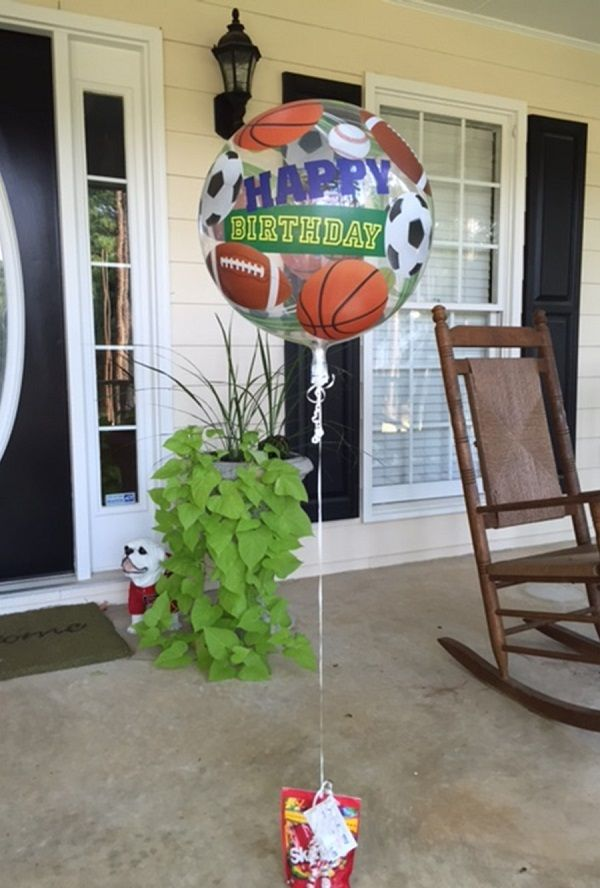 Need of a quick and easy birthday present? Pick out a balloon (shown: 284326 – HBD Sport Bubble) and add the birthday boy or girl's favorite candy to double as a balloon weight! Thank you to a b+B employee for sharing this idea and photo!