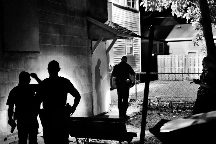 Paolo Pellegrin. Several police officers search a house for an armed suspect in NE Rochester. Rochester, NY. USA 2012