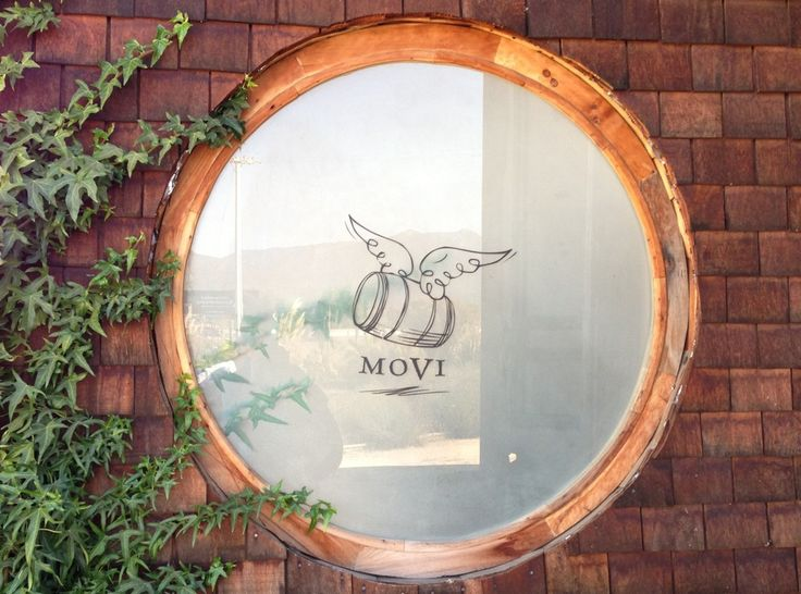 The logo for MOVI on the window at Casa Botha restaurant in Casablanca. Visit Casa Botha for a great meal, artisan wines and an eclectic, homey style.
