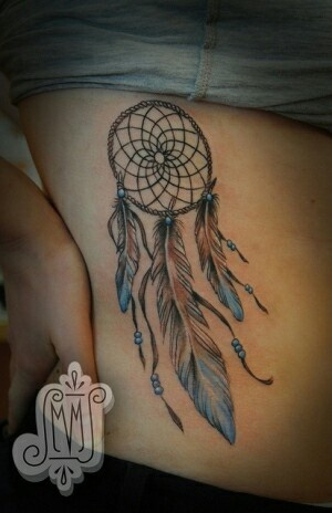 Dreamcatcher tattoo with really lovely colors.
