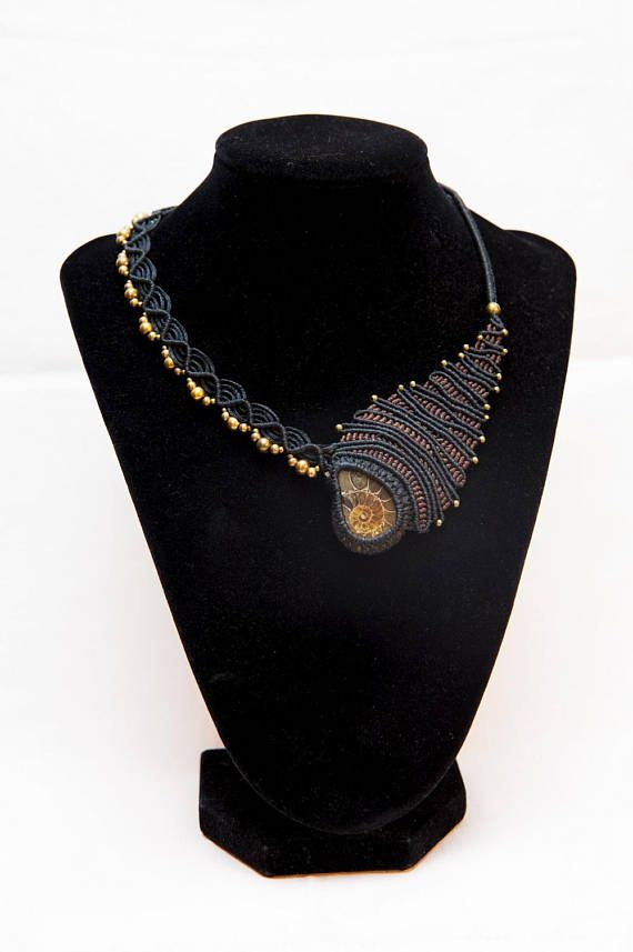 Hey, I found this really awesome Etsy listing at https://www.etsy.com/listing/575367523/fossil-amonite-macrame-statement